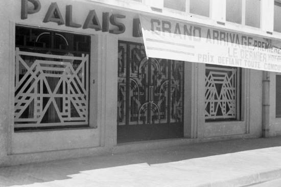 1940 storefront in Hanoi with grand opening sign