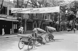 010a.1940 - Street scene under banner advertising lottery in Hanoi