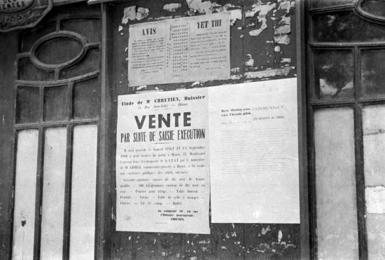 1940 - Public notices posted on door of building in Hanoi