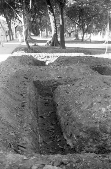 1940 - Air raid trenches dug at park in Hanoi-hào đào tại công viên ở Hà Nội tránh máy bay ném bom.