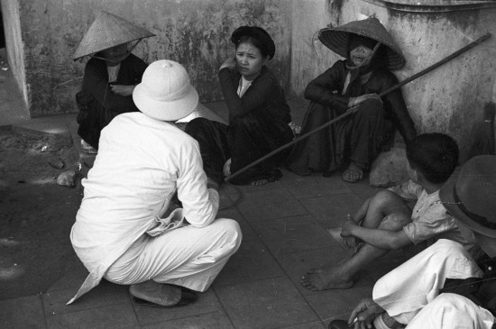 HANOI 1940 - People at a train station