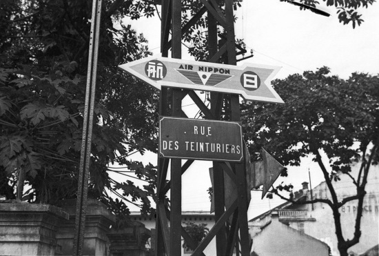Hanoi 1940 - Rue des Teinturiers and a sign for Air Nippon, a Japanese airline-(phố Thợ Nhuộm)