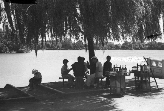 HANOI ca 1941 - Group of people eating by the lake