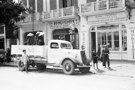 HANOI ca.1941 - Mobil Oil truck on city street