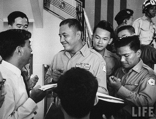 Nov 1963 - Major General, co-leader of military coup that overthrew Diem Regime, Van Minh Duong (Center) during press conference.
