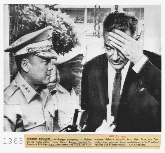 SERIOUS BUSINESS: In Saigon yesterday -- United States Ambassador Henry Cabot Lodge touched his furrowed brow during a conference with the South Viet Namese defense minister, Maj. Gen. Tran Van Don. Lodge had returned from conferences with President Johnson and Secretary Rusk.